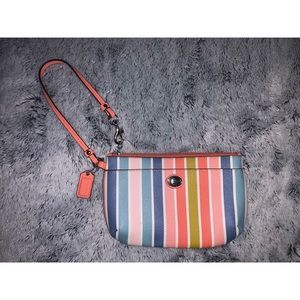 Coach multicolored striped wristlet